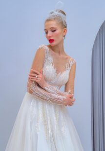 Style #2204L, long-sleeve A-line wedding dress with floral embroidery, available in ivory