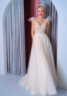Style #2201L, A-line wedding dress with bow straps and floral embroidered top, available in ivory, dark ivory