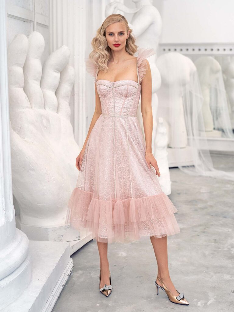 Style #628, sequinned lace A-line gown with a ruffle-tiered skirt, available in ivory, powder pink, grey-blue