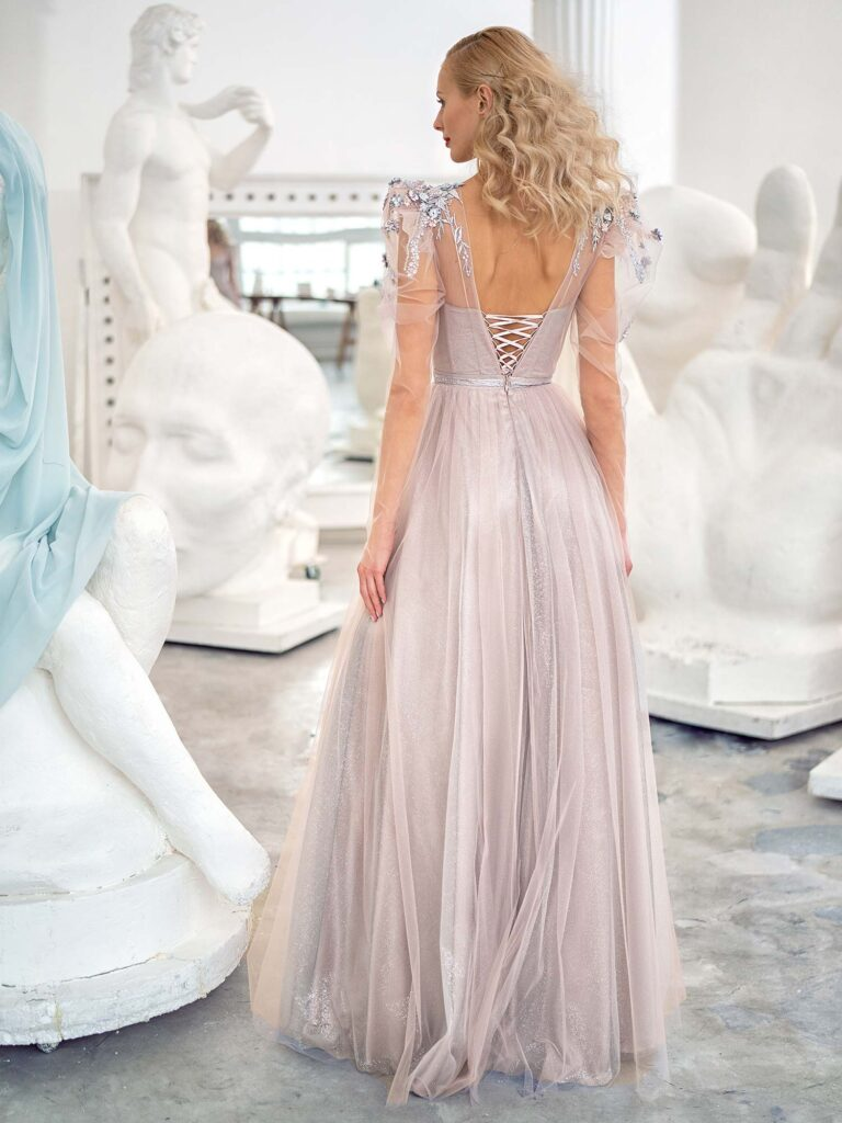 Style #632, shimmering A-line evening gown with long sleeves and puffed shoulders; available in grey-powder