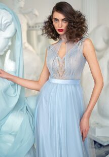 Style #633b, A-line evening dress with beaded bodice and illusion halter-style neckline; available in midi or maxi length; in grey-blue, ivory, powder, purple, cherry, black