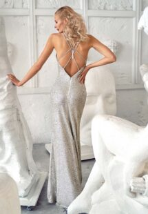 Style #637, fitted sequin gown with spaghetti straps and open back; available in silver, black