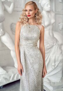 Style #640, sequin sheath gown with a high slit and open back; available in silver
