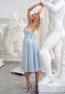 Style #645a, bustier style gown with tulle skirt and spaghetti straps; available in midi or maxi length; in grey-blue, powder, purple