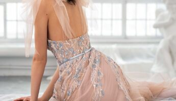 Style #647, bustier style A-line gown with floral embroidery and bow straps; available in nude -pink