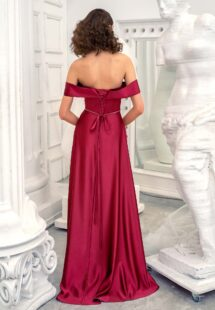 Style #649, satin sheath evening gown with off the shoulder sleeves and beaded belt; available in burgundy, ivory, green, red