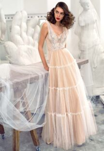 Style #660, tulle A-line evening dress with floral embroidered top and layered skirt; available in ivory-nude, pink-nude