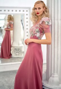 Style #668, short sleeve sheath evening gown with extended shoulders and embroidered top; available in lilac, pink