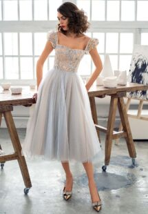 Style #669b, A-line cocktail dress with puffed sleeves and embroidered top; available in mini, midi or maxi length; in nude-blue, nude-pink